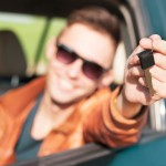 Young man showing car keys - Stock Image